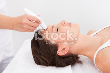 stock-photo-39543626-woman-under-going-microdermabrasion-treatment